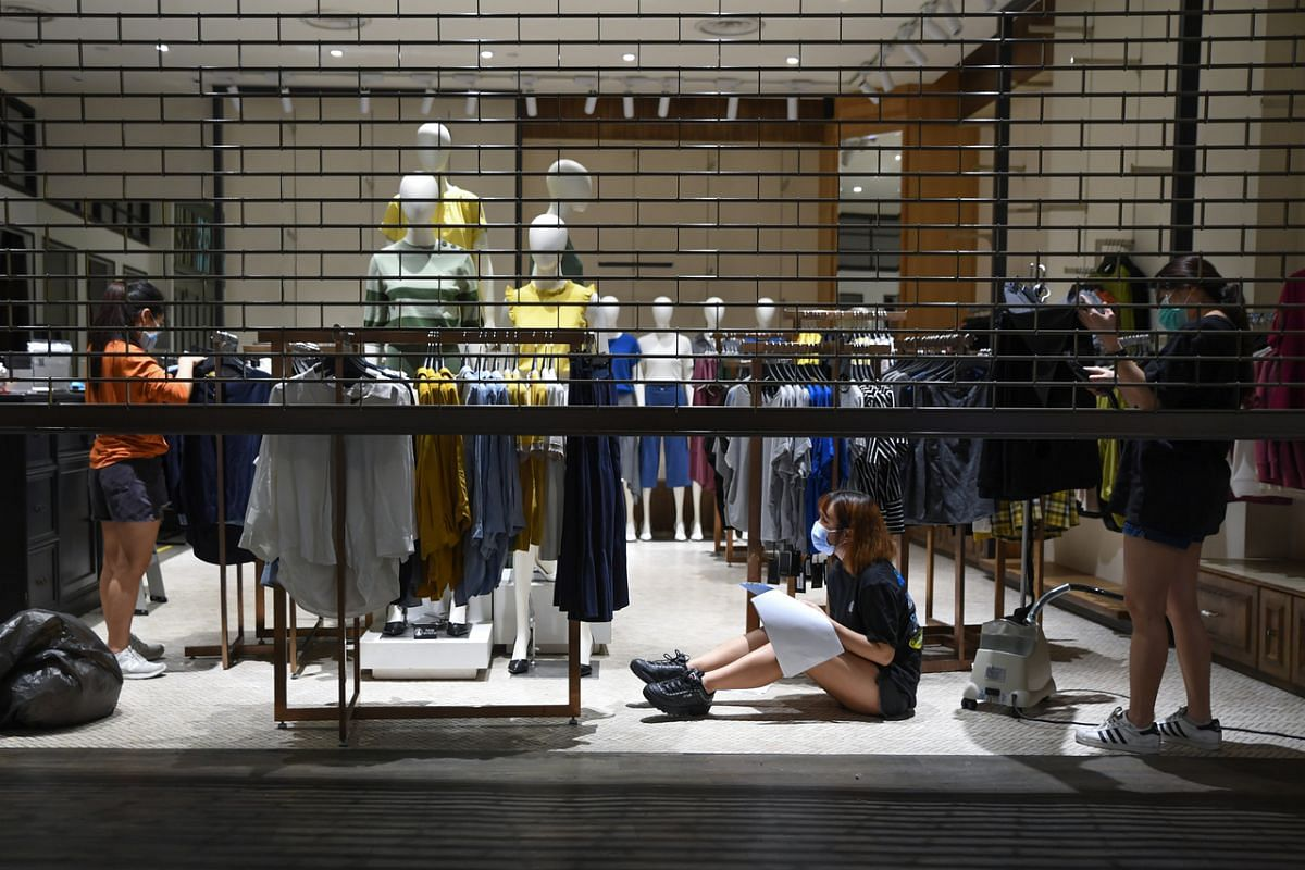 Staff at a clothing store in City Square Mall preparing for reopening, on June 18, 2020.