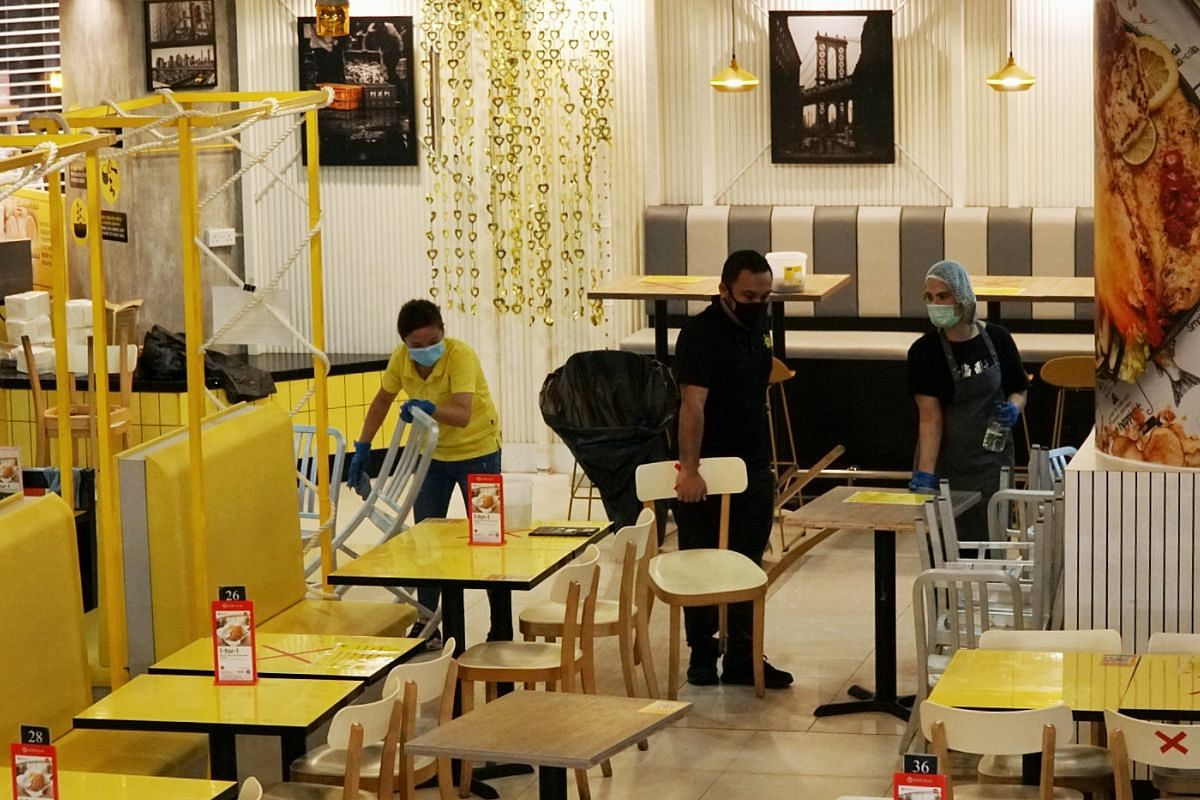 Staff at The Manhattan Fish Market restaurant in Causeway Point preparing for reopening, on June 18, 2020.