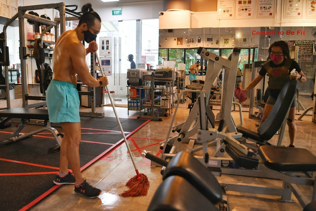 Bespoke Fitness owner Lim Tiat and his sister Lin Yan preparing the studio for the reopening, on June 18, 2020.