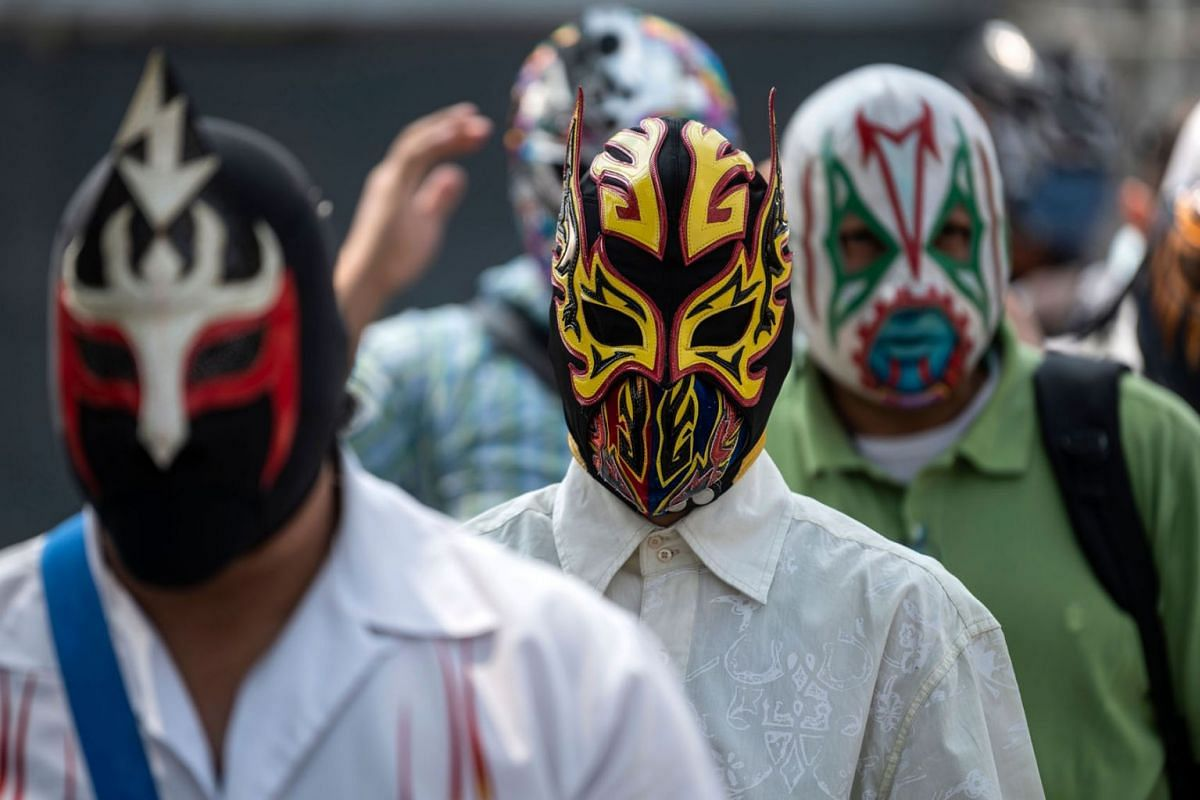Mexican fighters wait in line to receive supplies since arenas are closed due to the the coronavirus pandemic and they are facing economic difficulties, in Mexico City, on June 17, 2020. PHOTO:  AFP