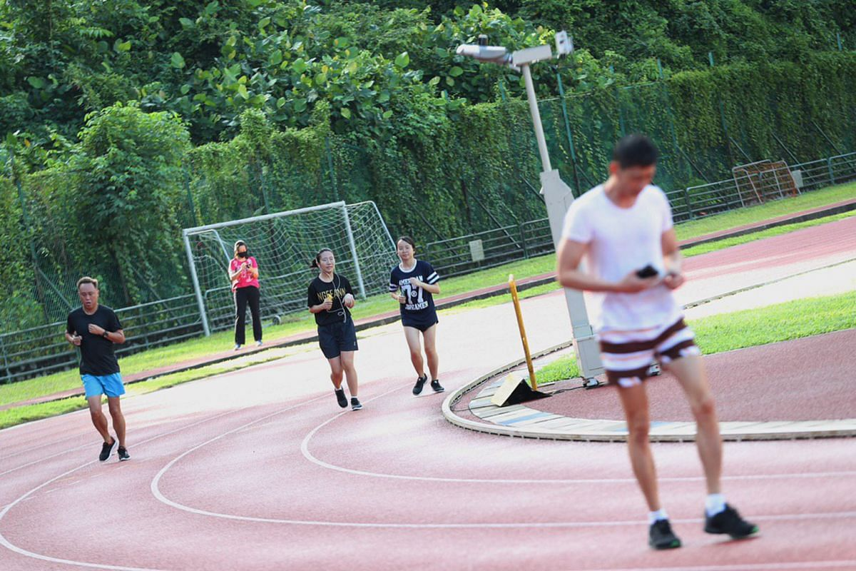People exercise at Bukit Gombak Stadium, on June 19, 2020.