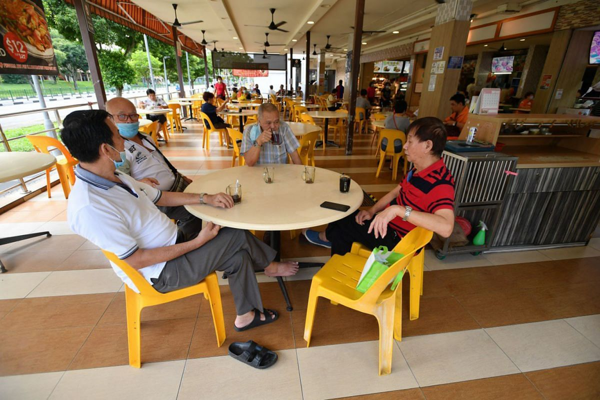 Customers at a food court at Blk 827 Tampines Street 81, on June 19, 2020.