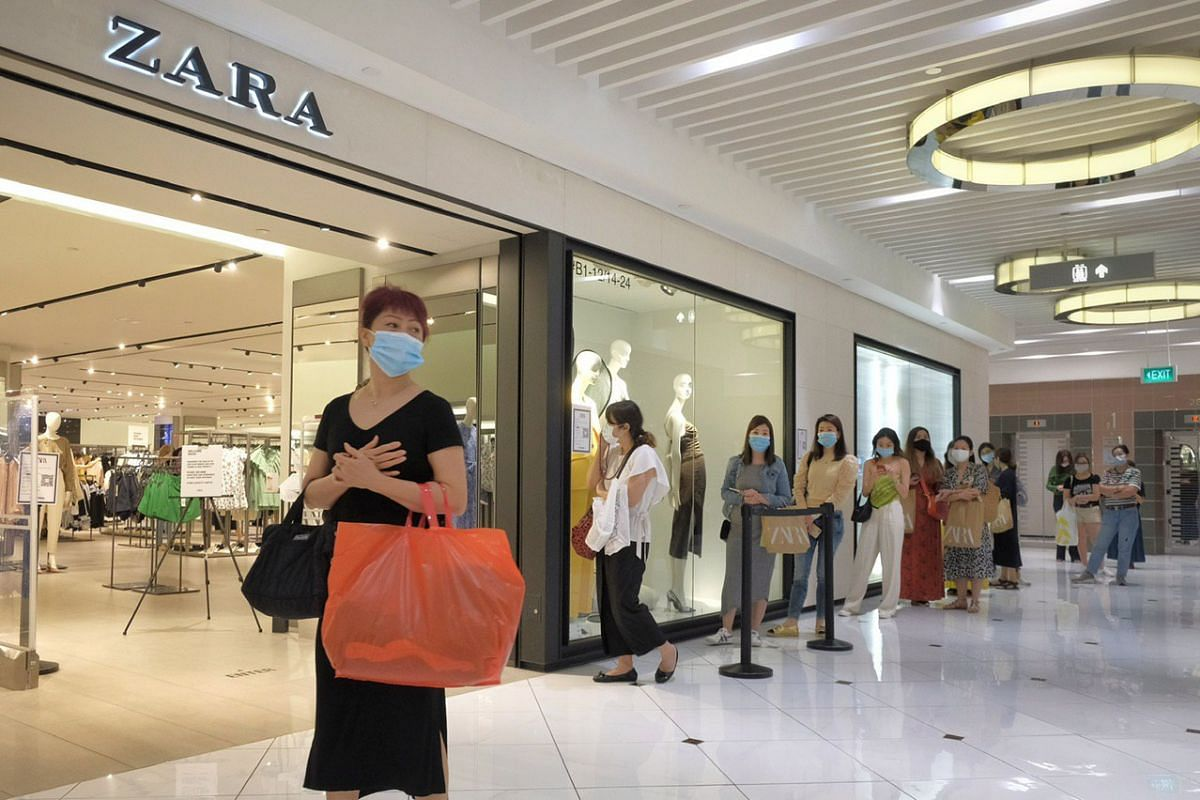 Shoppers queueing to enter the Zara store in Ngee Ann City on June 19, 2020.