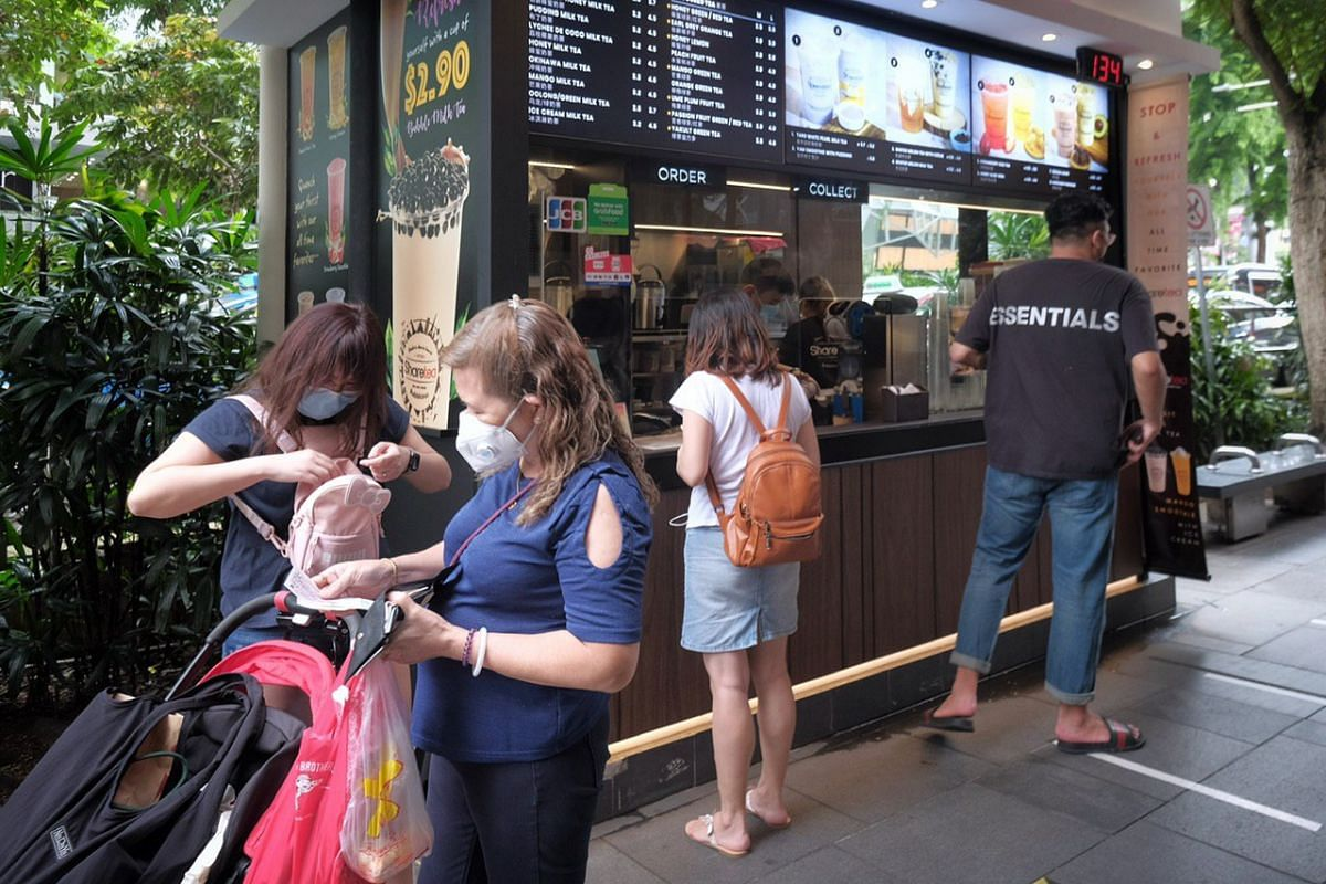 People buying bubble tea along Orchard Road on June 19, 2020.