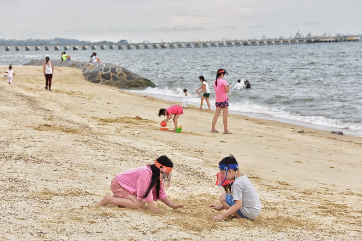 Children playing on the beach at East Coast Park on June 19, 2020.