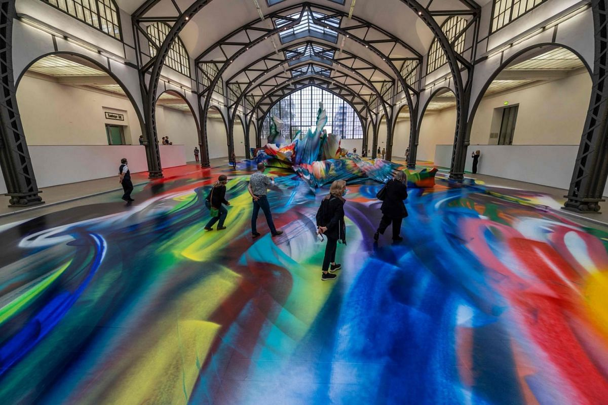 "Visitors take in German artist Katharina Grosse's installation ""It Wasn't Us"" at Berlin's Hamburger Bahnhof museum for contemporary art on June 19, 2020. PHOTO: AFP"