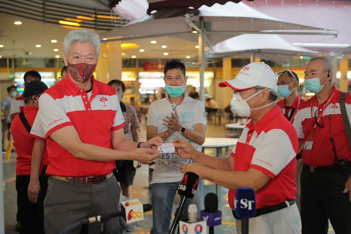 Mr Lee Hsien Yang (left), the estranged brother of Prime Minister Lee Hsien Loong, being presented with a Progress Singapore Party (PSP) membership card after joining Tan Cheng Bok's (right) political party as seen in a photo taken at Tiong Bahru Mar