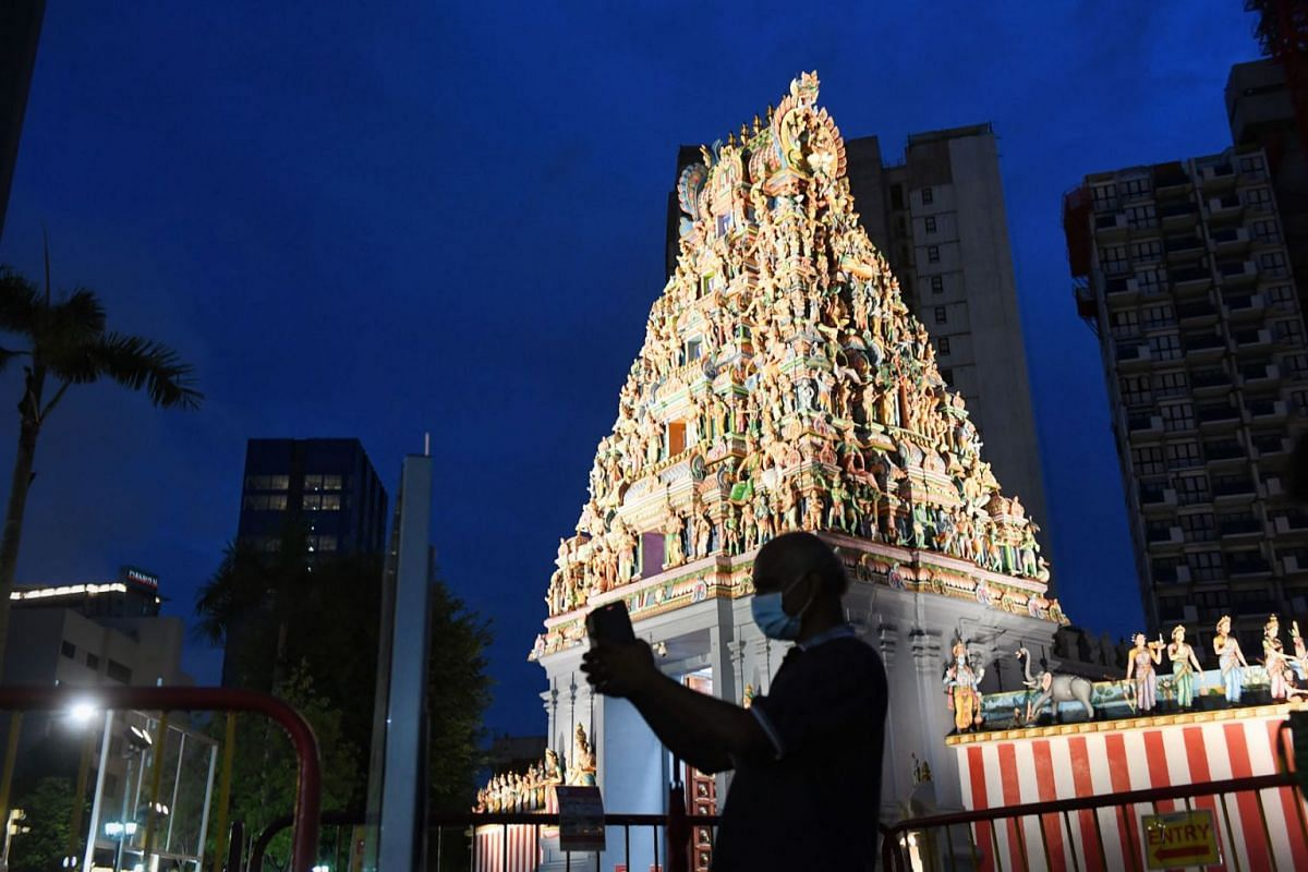 A man scans the SafeEntry QR code outside Sri Srinivasa Perumal Temple on June 24, 2020. PHOTO: THE STRAITS TIMES/SHINTARO TAY