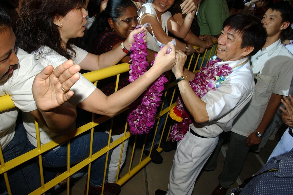 Mr Khaw Boon Wan shaking hands with the crowd at the Sembawang GRC rally in 2006.