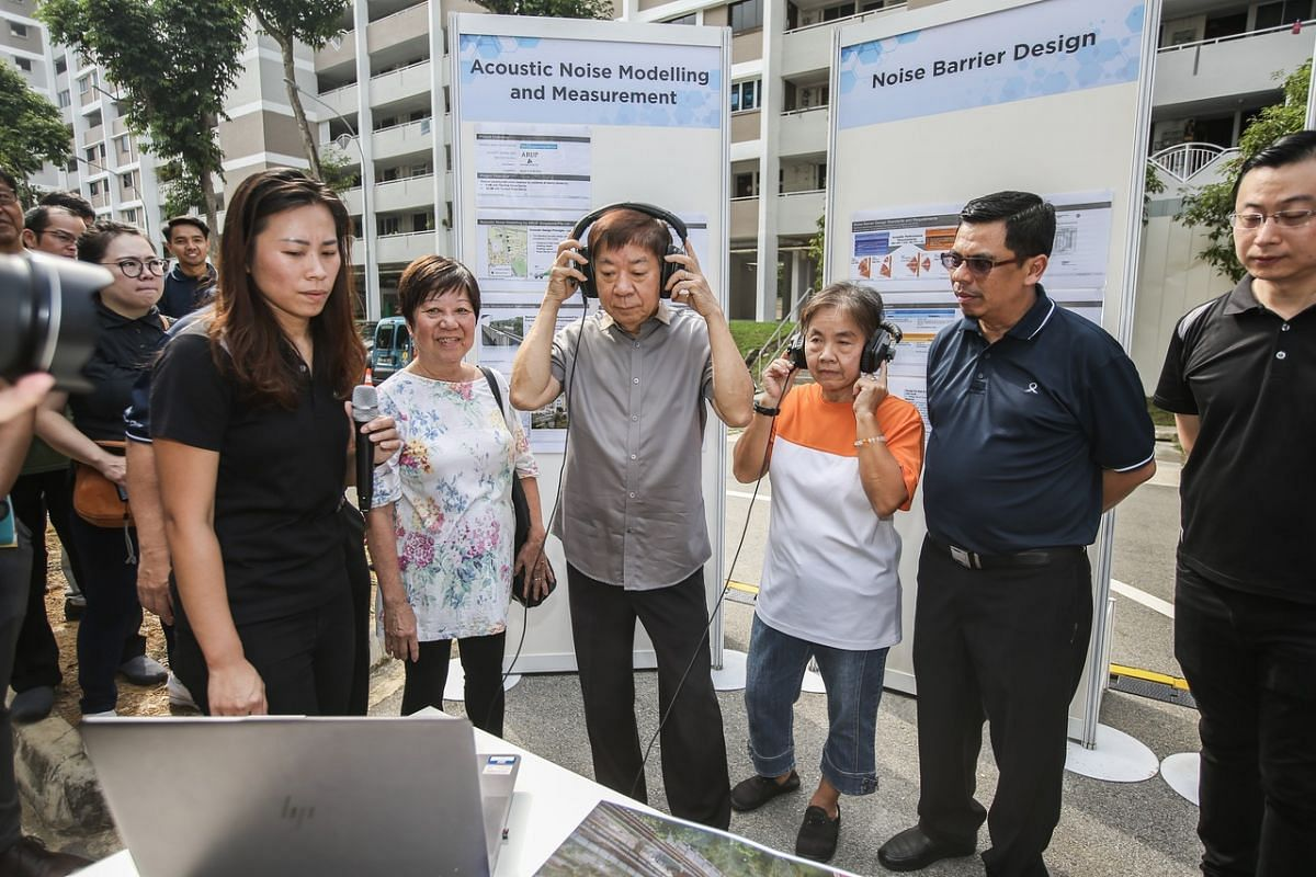 Transport Minister Khaw Boon Wan's (centre) visit to view railway noise barriers at a HDB carpark in Ang Mo Kio in 2019.