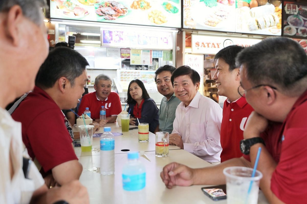 NTUC secretary-general Ng Chee Meng (second from right), Transport Minister Khaw Boon Wan and (at the end of table), NTUC assistant director-general Ang Hin Kee, meeting private-hire and taxi drivers at Newton Hawker Centre on Feb 12, 2020.