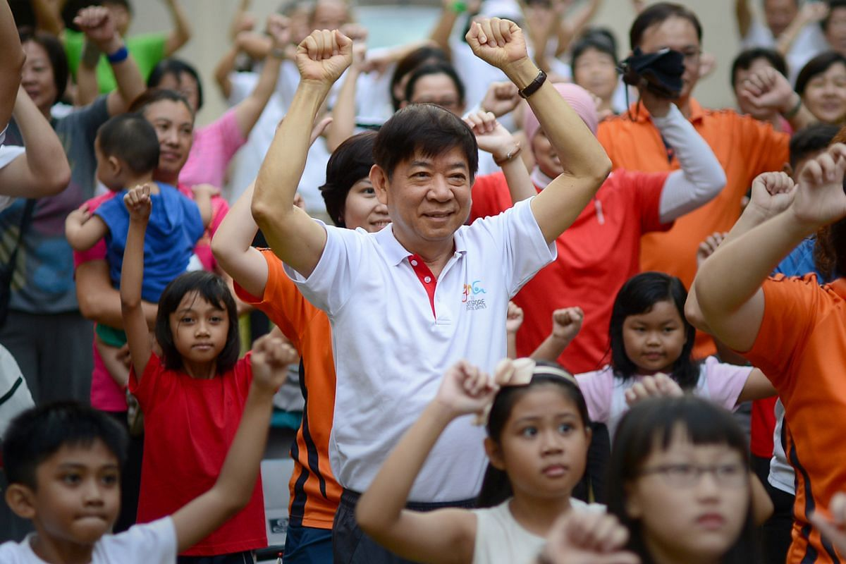 Mr Khaw Boon Wan (centre) taking part in a workout at a Sembawang Zone F Residents' Committee mass walk and open-house event on March 10, 2013.