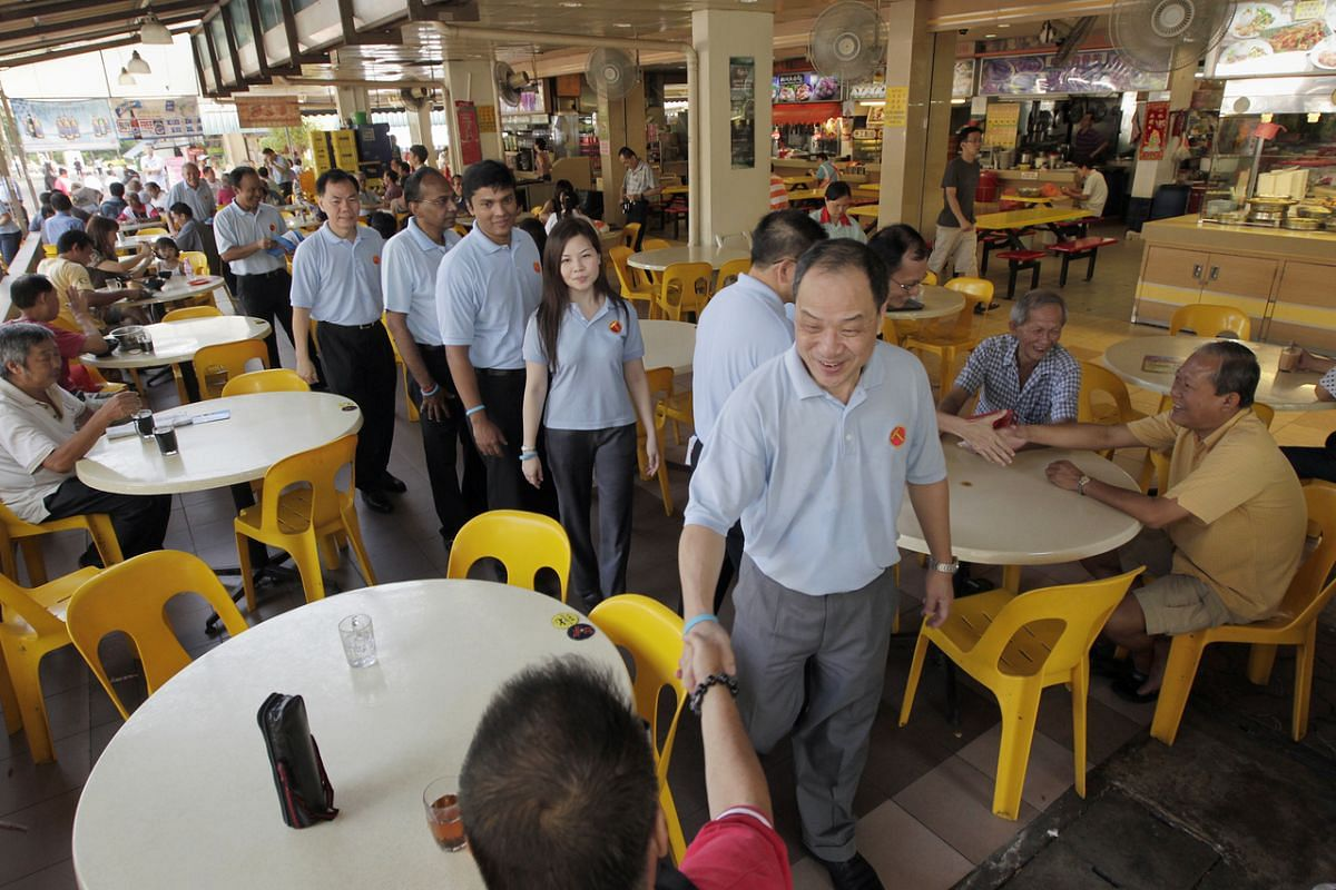 Mr Low with party members in Yishun on April 3, 2011.
