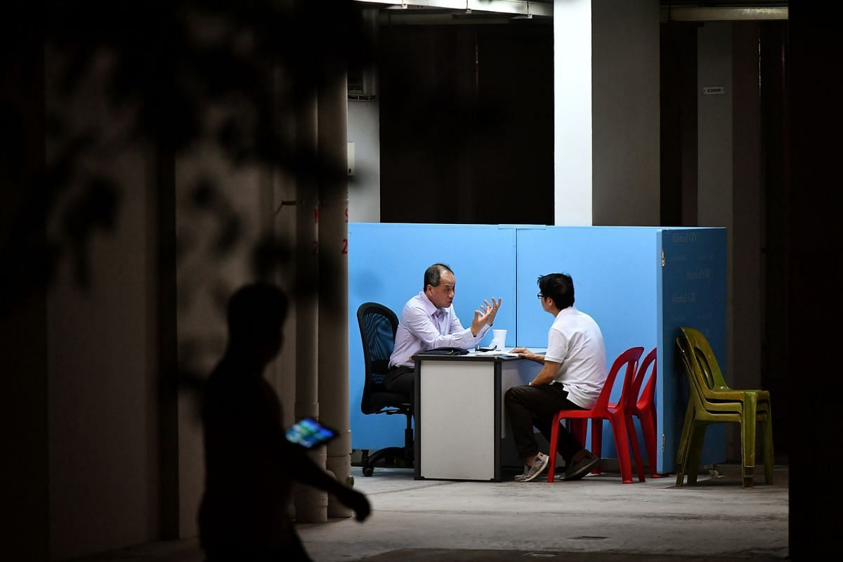 Mr Low, at his last Meet-the-People Session as Secretary-General of Workers' Party, at the void deck of Block 522 Hougang Avenue 6, on April 4, 2018.