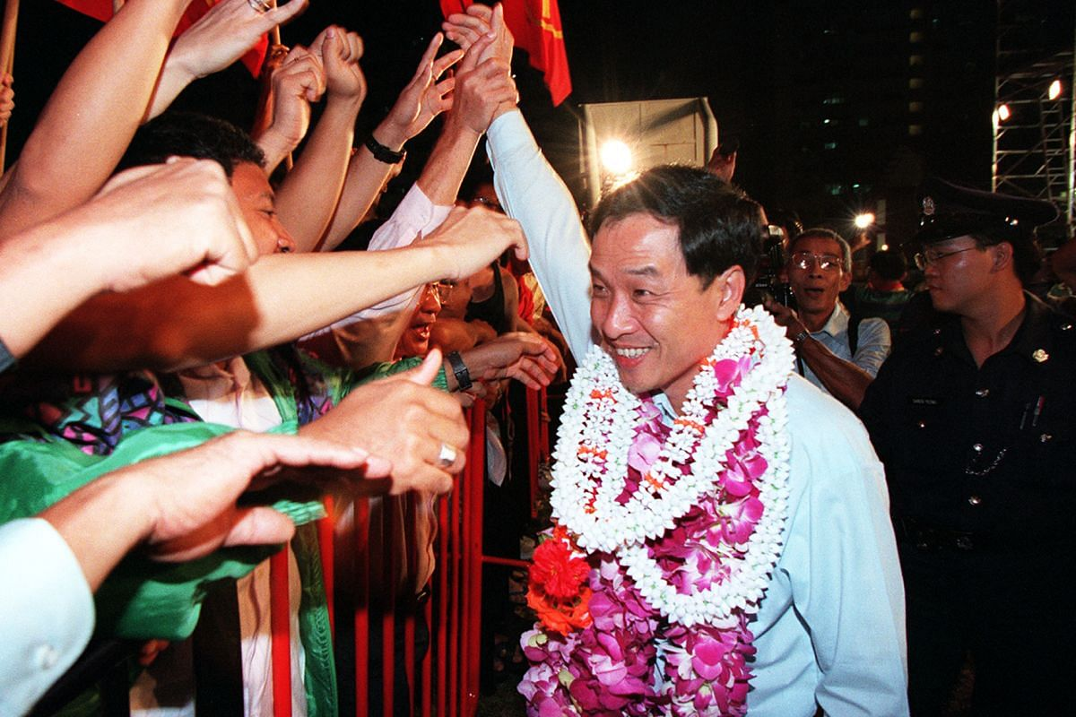 Mr Low with supporters in 1997.