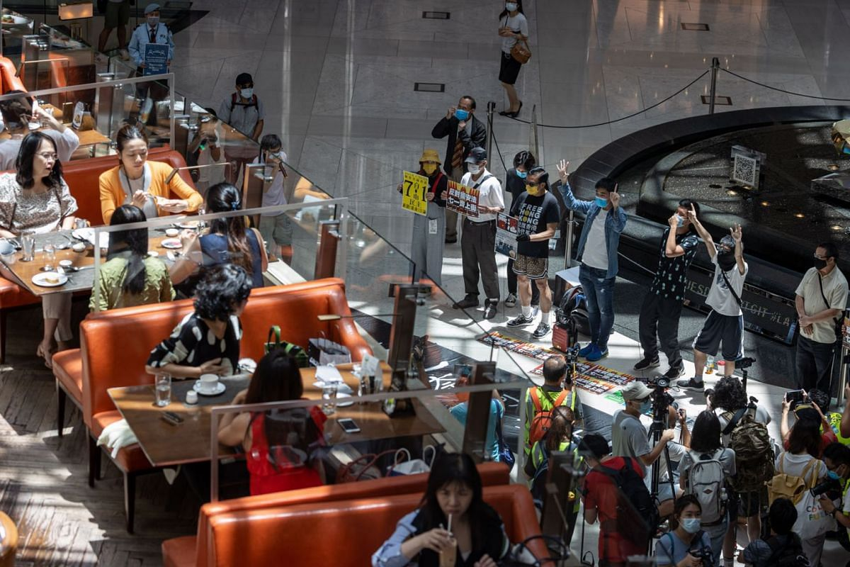 Pro-democracy protesters take part in a 'lunch with you' rally at a shopping mall in Hong Kong, China, June 30, 2020. PHOTO: EPA-EFE