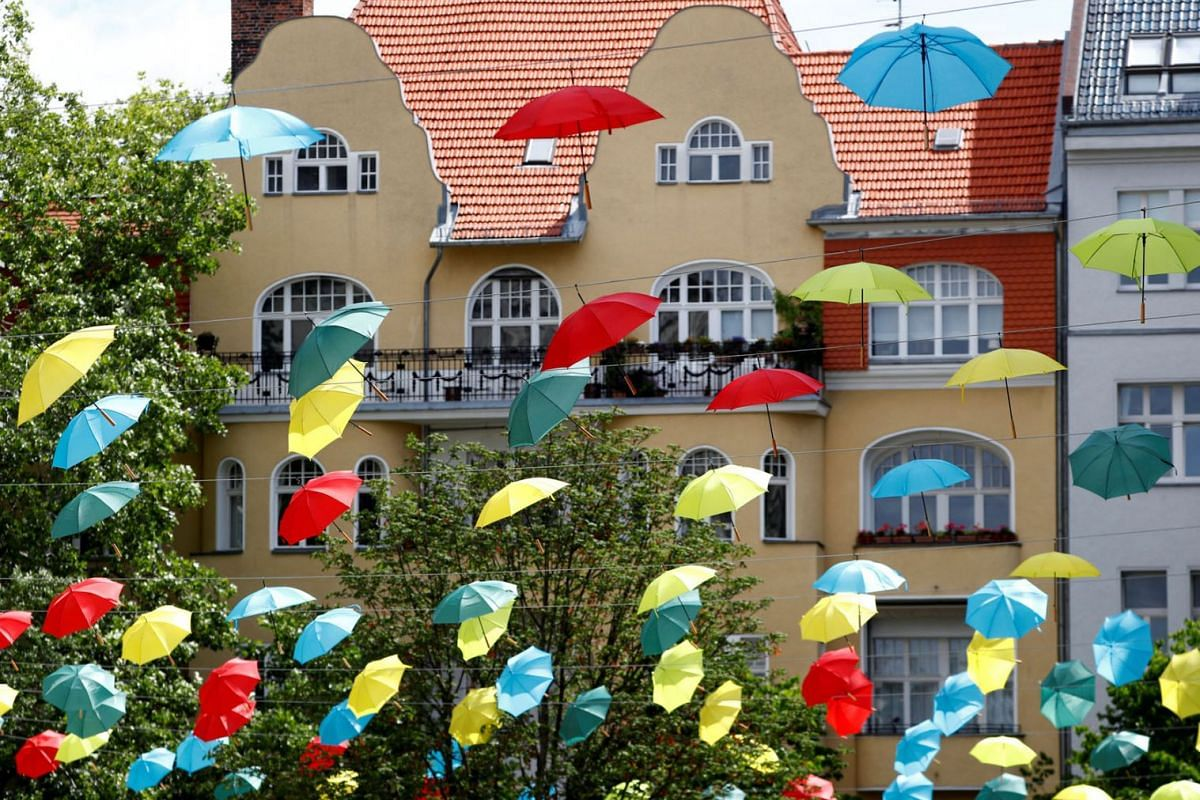 Coloured umbrellas are hanging on ropes over a square to advertise an upcoming wine festival at Berlin's Charlottenburg district in Berlin, Germany, June 30, 2020. PHOTO: REUTERS