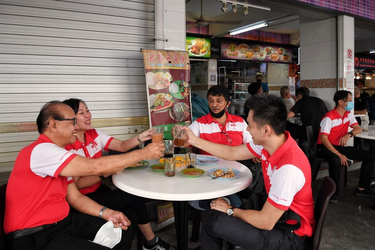 PSP's Tanjong Pagar GRC candidates (from left) Abas Kasmani, Wendy Low, Harish Pillay and Terence Soon at a coffee shop opposite the Bendemeer Primary School nomination centre.