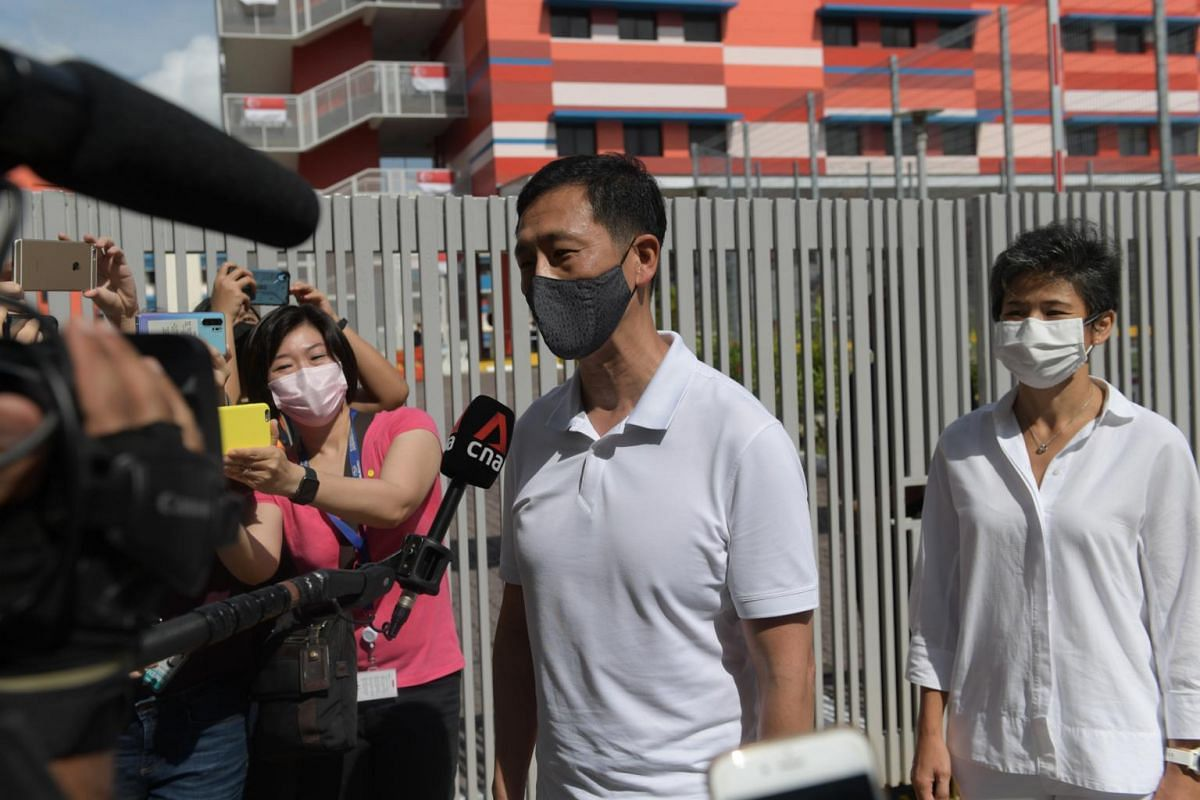 Education Minister Ong Ye Kung and newcomer Poh Li San, part of the PAP team contesting Sembawang GRC, arrive at the Chongfu School nomination centre.