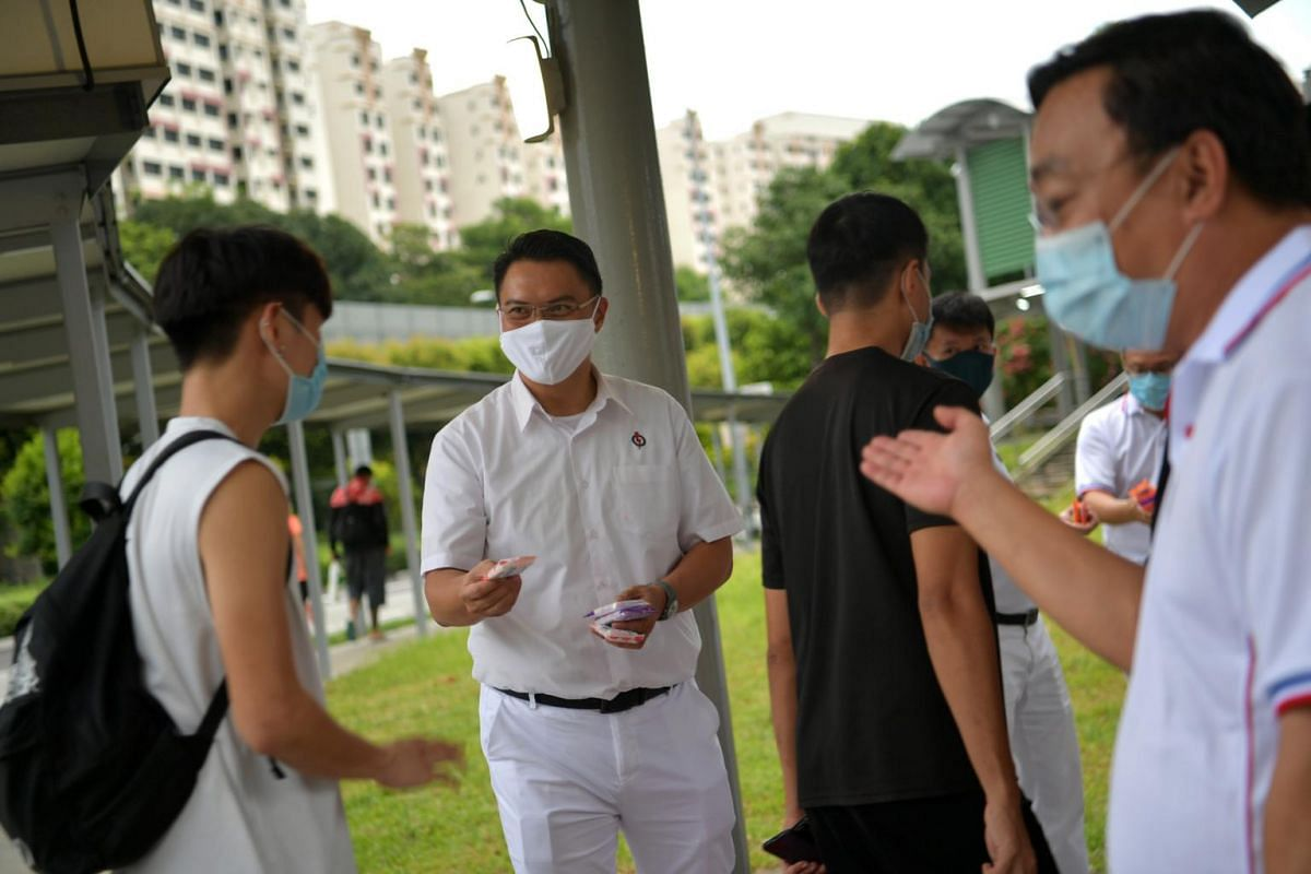 PAP's Mr Patrick Tay gives out anti-bacterial wipes in Jurong West Street 64, on June 30, 2020.