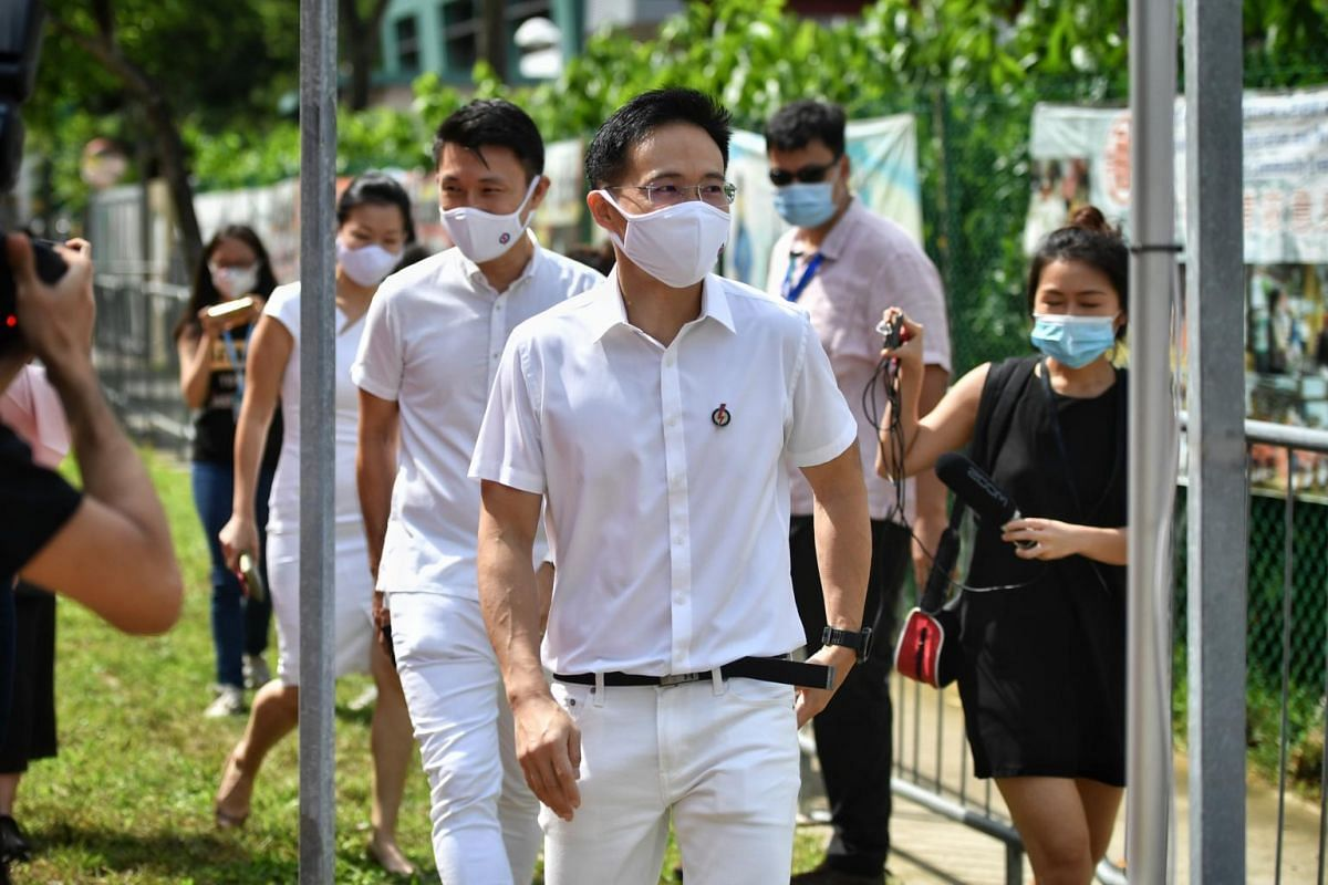 PAP's Tampines GRC candidates Desmond Choo, Baey Yam Keng and Cheng Li Hui on their way to the Poi Ching School nomination centre.