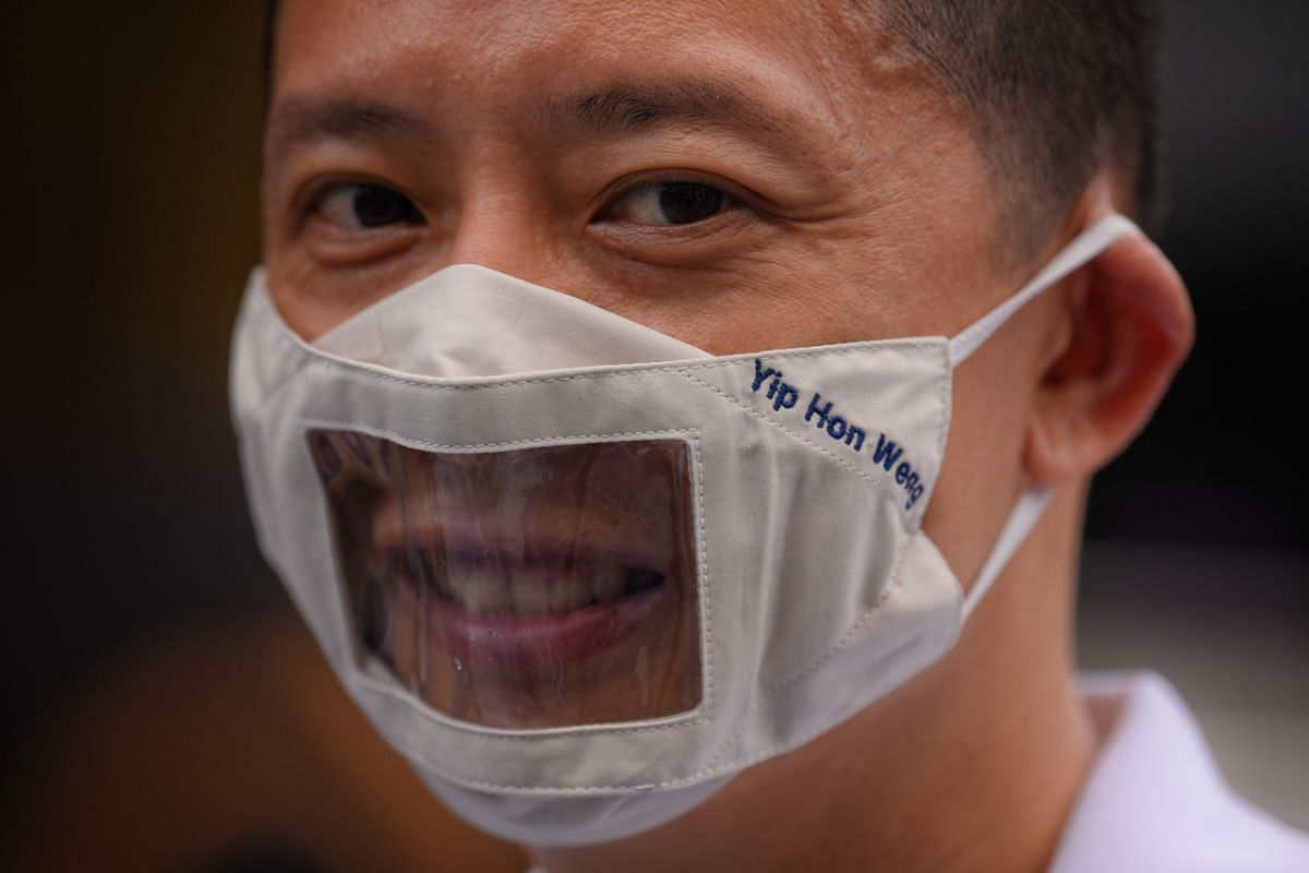 PAP candidate for Yio Chu Kang SMC Yip Hon Weng dons a customised mask before going on a short walkabout at Ang Mo Kio Town Centre on July 1, 2020.