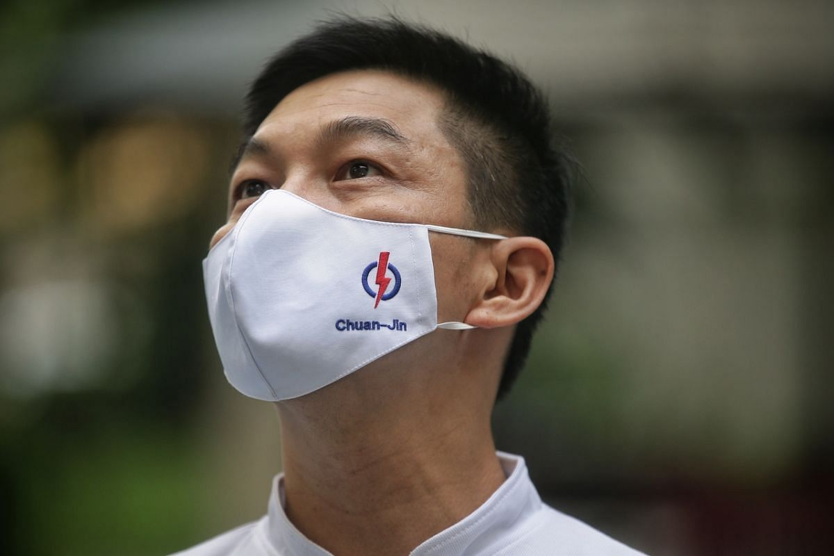 People's Action Party (PAP) candidate from the Marine Parade GRC team, Mr Tan Chuan-Jin, wears a mask that bears his name during a doorstop interview in Serangoon Avenue 3 on July 2, 2020.