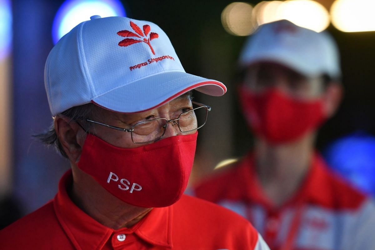 PSP chief Tan Cheng Bock wears a mask in the party's colour red and stitched with the party name during a walkabout at Jurong Point on July 4, 2020.