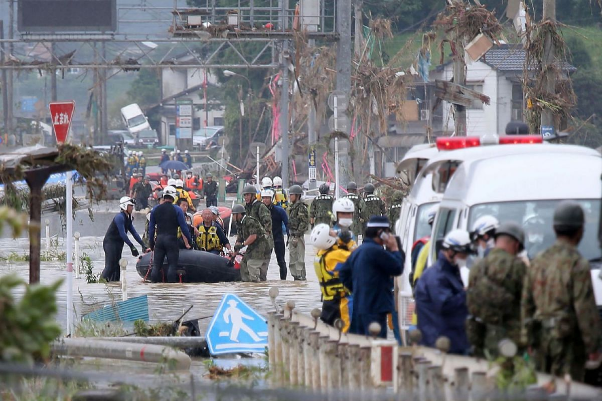 Residents are evacuated from flood-affected area by rubber boats in Kuma village, Kumamoto prefecture, on July 5, 2020. PHOTO: JIJI PRESS VIA AFP