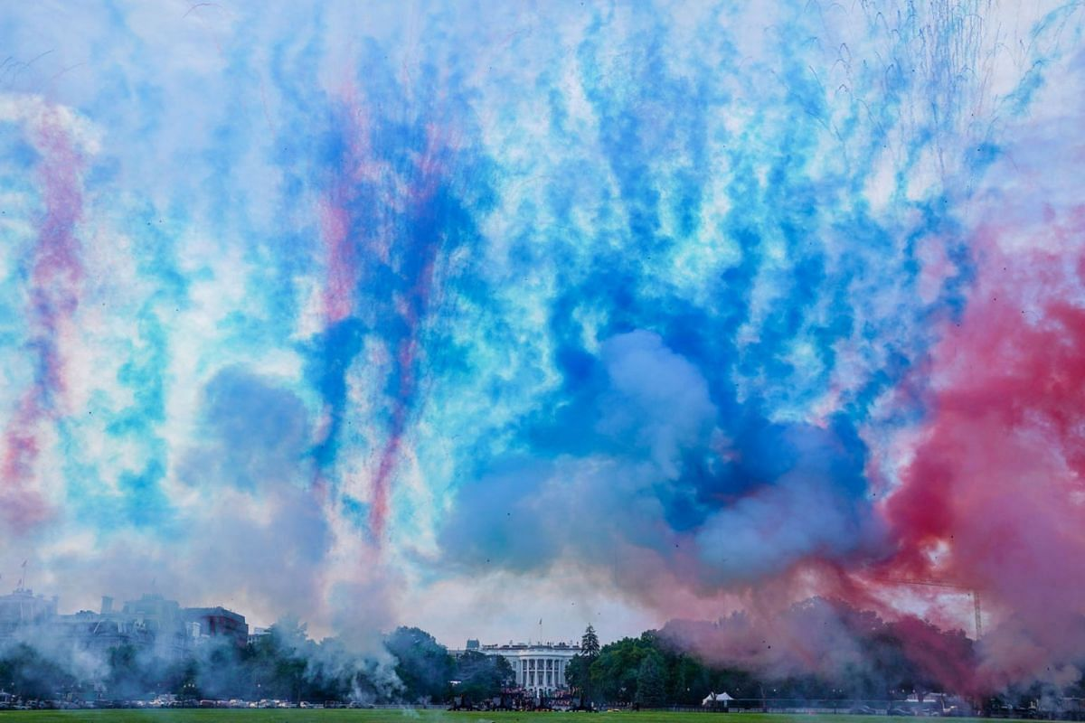 """Red and blue smoke is fired at the Ellipse of the White House during the """"Salute to America"""" event held to celebrate Fourth of July Independence Day in Washington, U.S., July 4, 2020. PHOTO: REUTERS"""