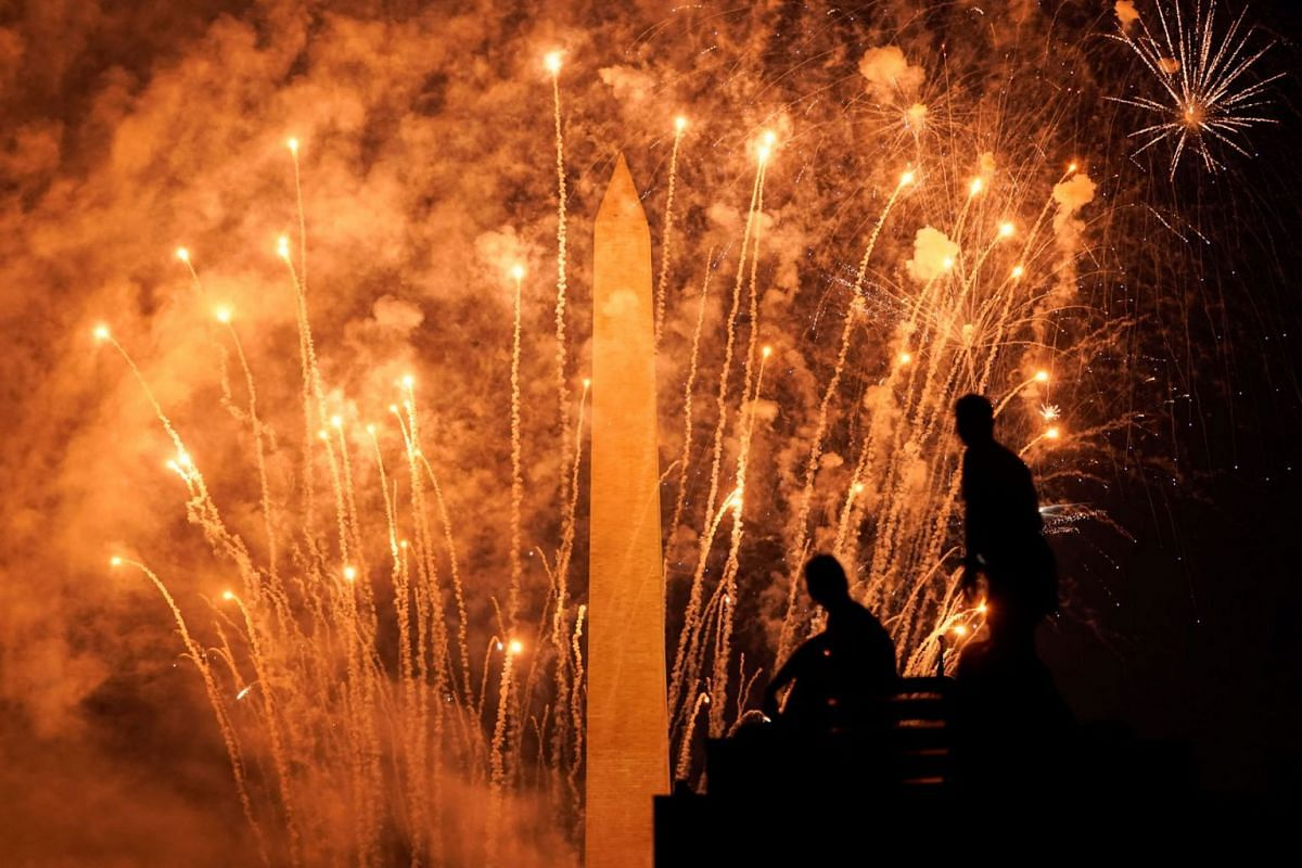 People watch the fireworks near the Washington Monument during Independence Day celebrations in Washington, U.S., July 4, 2020. PHOTO: REUTERS