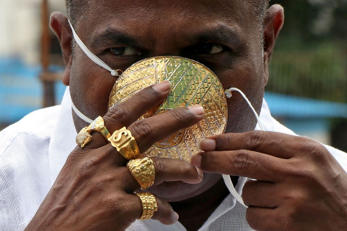 Shankar Kurhade (48), wears his face mask made out of gold as he poses for a photograph amidst the spread of the coronavirus disease  in Pune, India, July 4, 2020. Kurhade claims the mask weighs 50 grams and costs around $3870. PHOTO: REUTERS