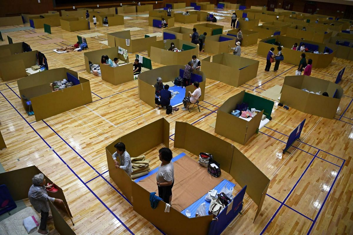 Local residents take shelter at an evacuation centre with space to maintain social distance in Yatsushiro city general gymnasium, Kumamoto prefecture, on July 6, 2020.  PHOTO: AFP