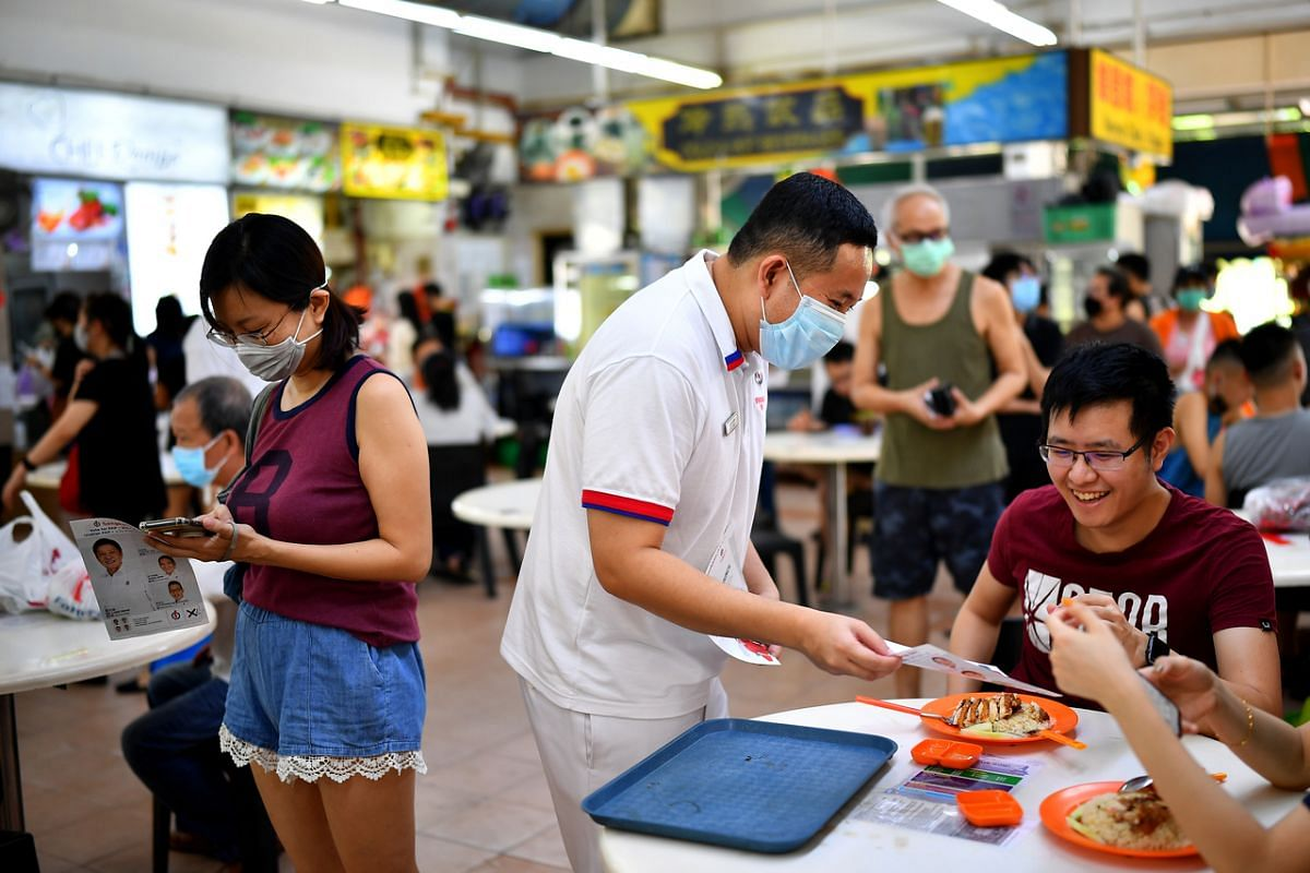 Senior Parliamentary Secretary for Home Affairs and Health Amrin Amin, PAP candidate for Sengkang GRC, interacting with residents at Anchorvale 303 Foodcourt on July 6, 2020.