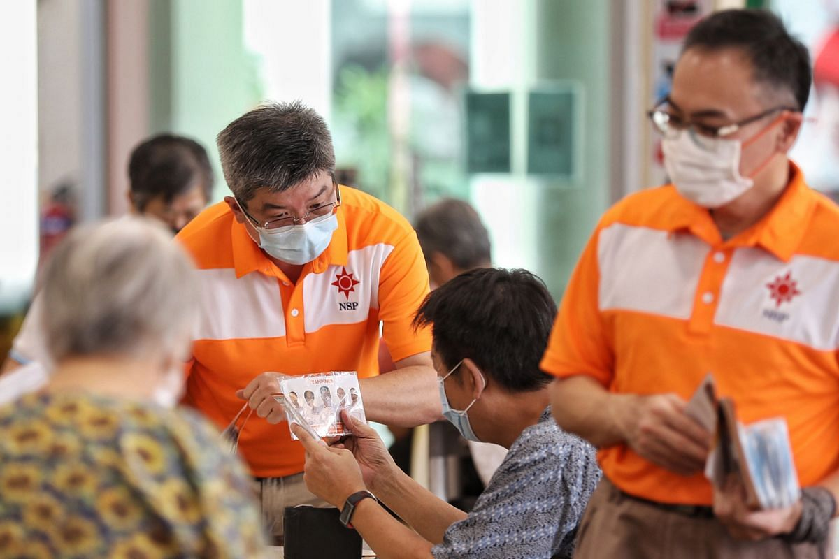 (From left) Mr Reno Fong and Mr Choong Hon Heng of the NSP on a walkabout in Tampines Mart on July 6, 2020.