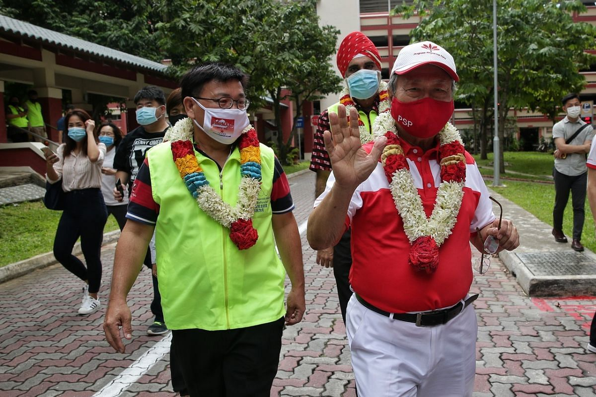 PSP candidate for West Coast GRC Tan Cheng Bock is accompanied by SDA candidate for Pasir Ris-Punggol GRC Desmond Lim Bak Chuan to his car during a meet-up in Pasir Ris on July 6, 2020.