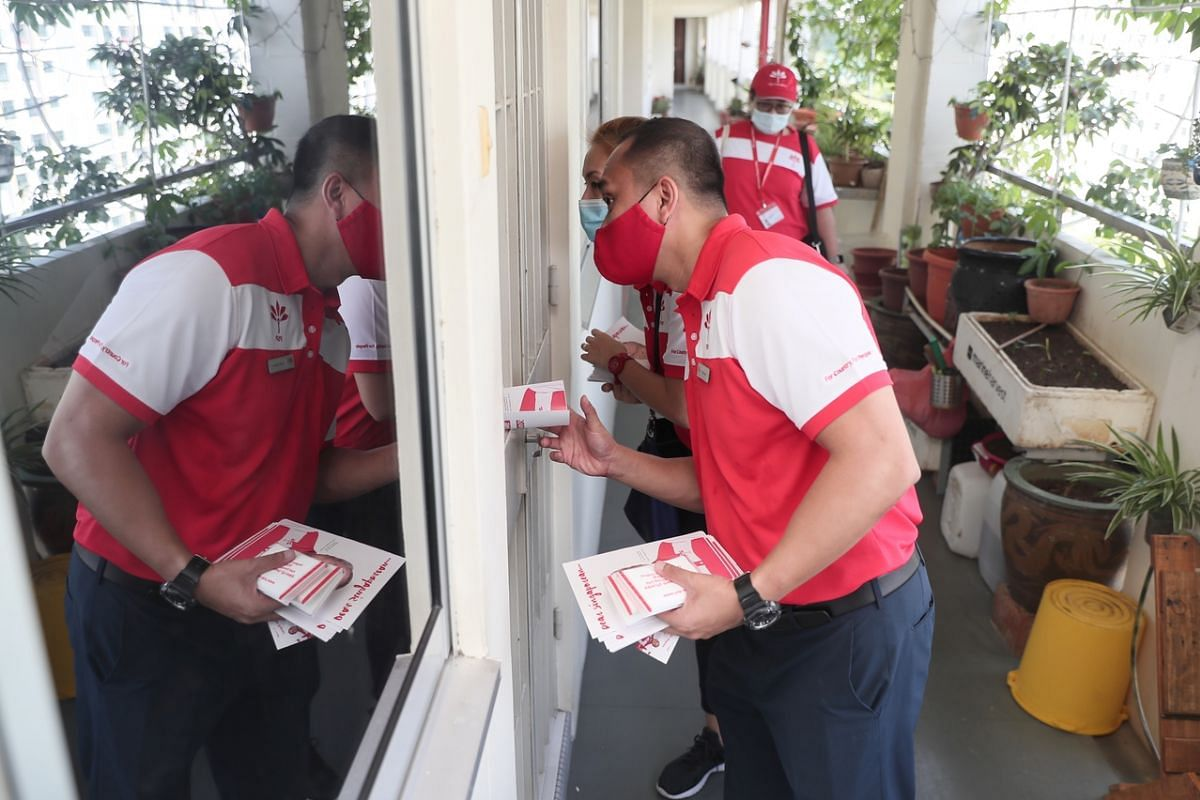 Nee Soon GRC candidate for PSP Taufik Supan on house-to-house visits at Block 419 Yishun Ring Road on July 6, 2020.