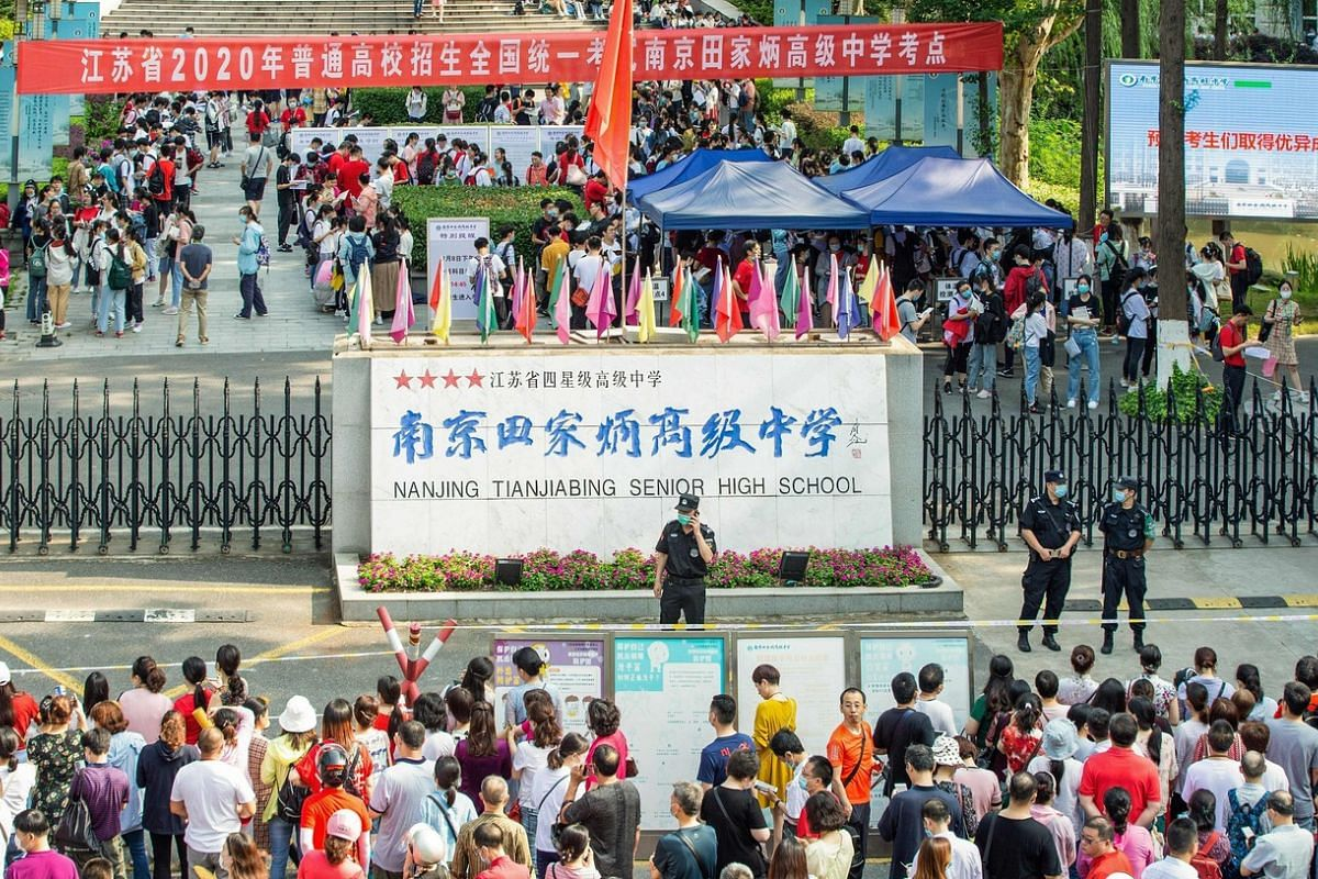 Students arrive at a school to sit the National College Entrance Examination in Nanjing, China, on July 7, 2020.