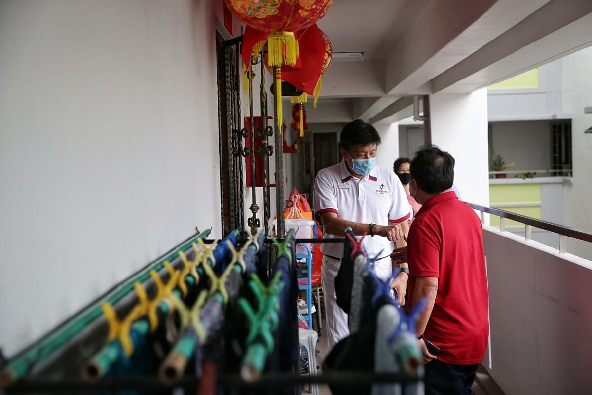 Labour chief Ng Chee Meng, who is leading the PAP's team for Sengkang GRC, during a block visit in Compassvale Street on July 7, 2020.