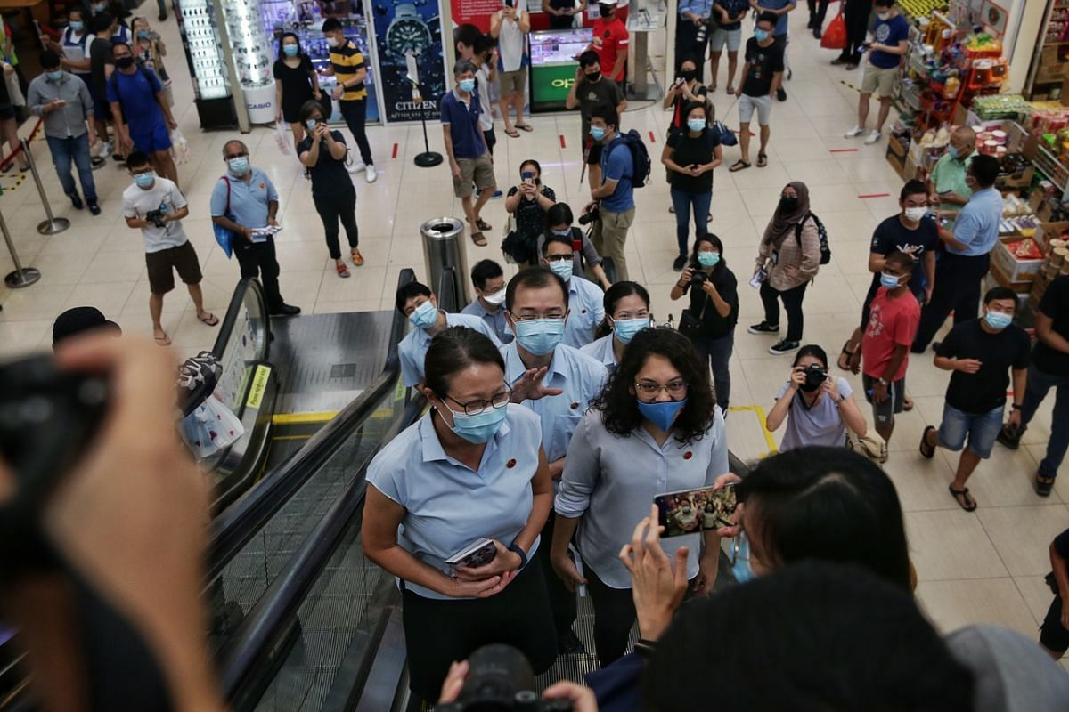 The Workers' Party's Sengkang GRC candidates Jamus Lim, Louis Chua, He Ting Ru and Raeesah Khan, accompanied by party chairman Sylvia Lim and secretary-general Pritam Singh, at Rivervale Plaza on July 7, 2020.