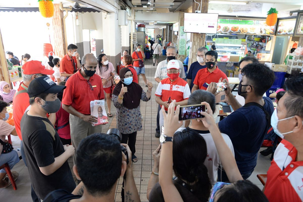 The Singapore Democratic Party's Professor Paul Tambyah (holding fliers) and Dr Tan Cheng Bock from the Progress Singapore Party during a walkabout in Bangkit Road on July 7, 2020.