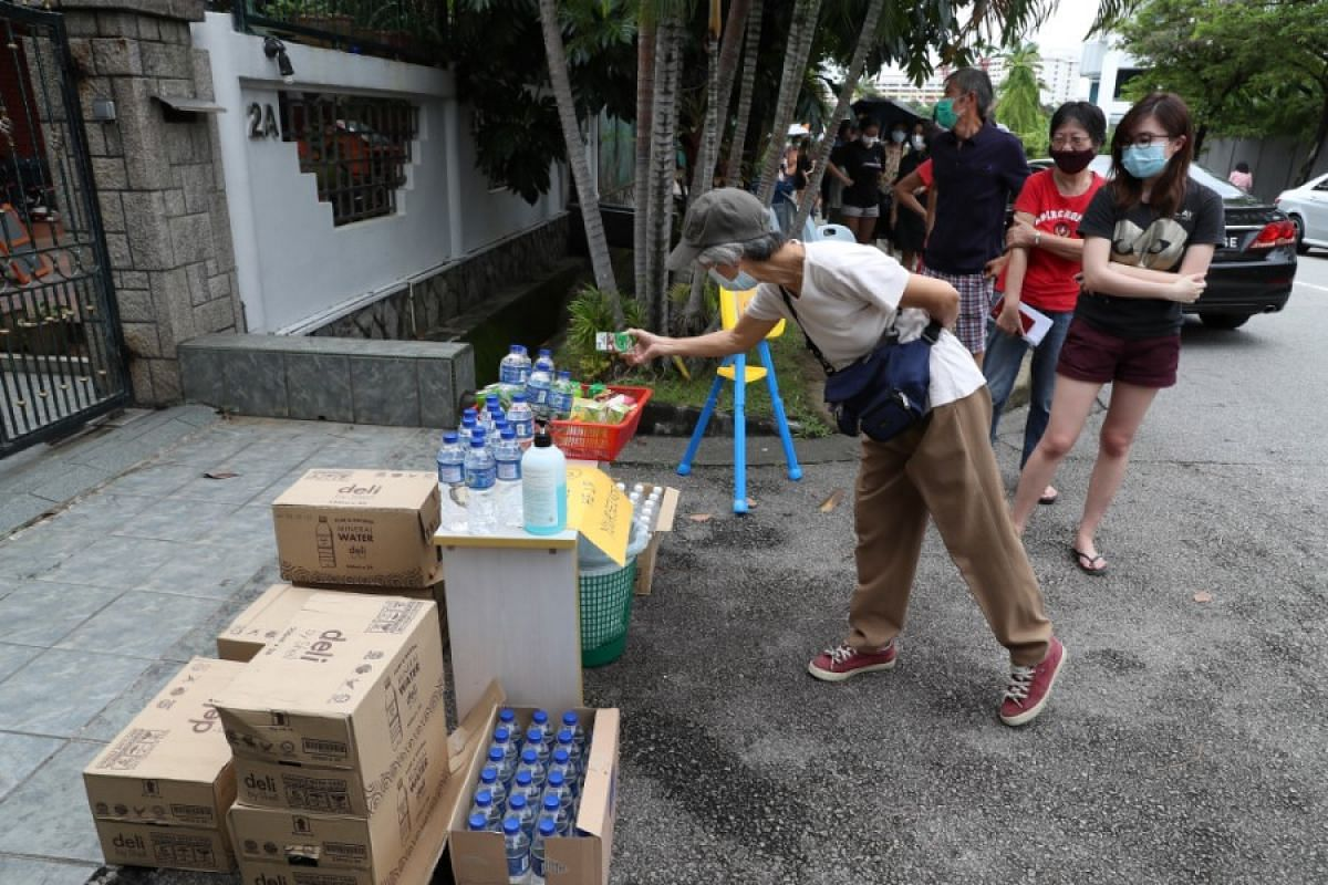 A makeshift drink stall set up by a resident outside his house about 130m from the polling station at CHIJ Our Lady of Good Counsel.