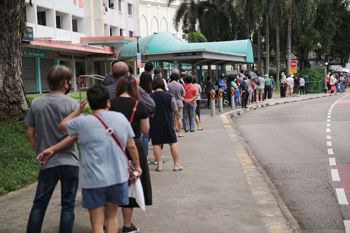 Voters queue to vote at polling station CHIJ Secondary school, on July 10, 2020.