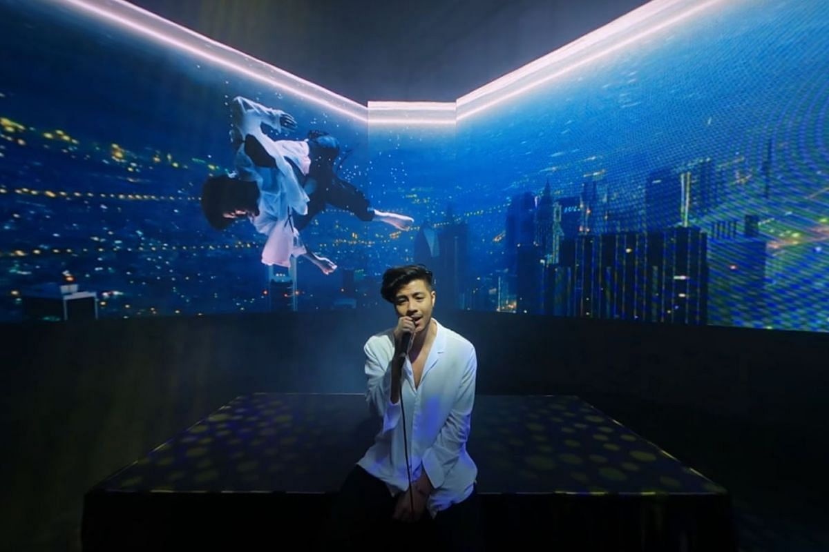 Benjamin Kheng singing Make Do in the ChildAid concert from home on July 15, 2020, which also featured Nathan Hartono and orchestra conductor Wong Kah Chun. PHOTO: THE STRAITS TIMES