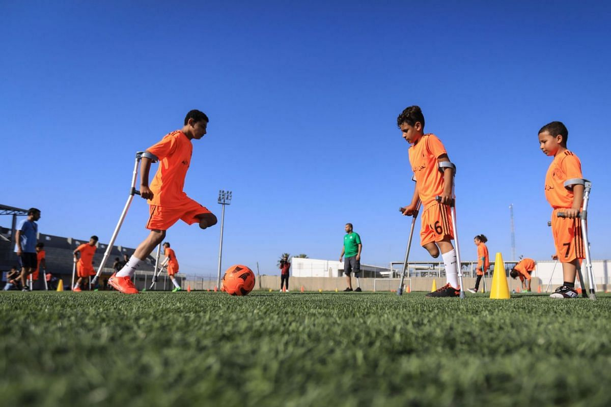 Palestinian amputee children participate in a soccer training session, arranged by the International Committee of the Red Cross (ICRC) after the coronavirus disease restrictions were eased, in Deir al-Balah in the central Gaza Strip on July 14, 2020.