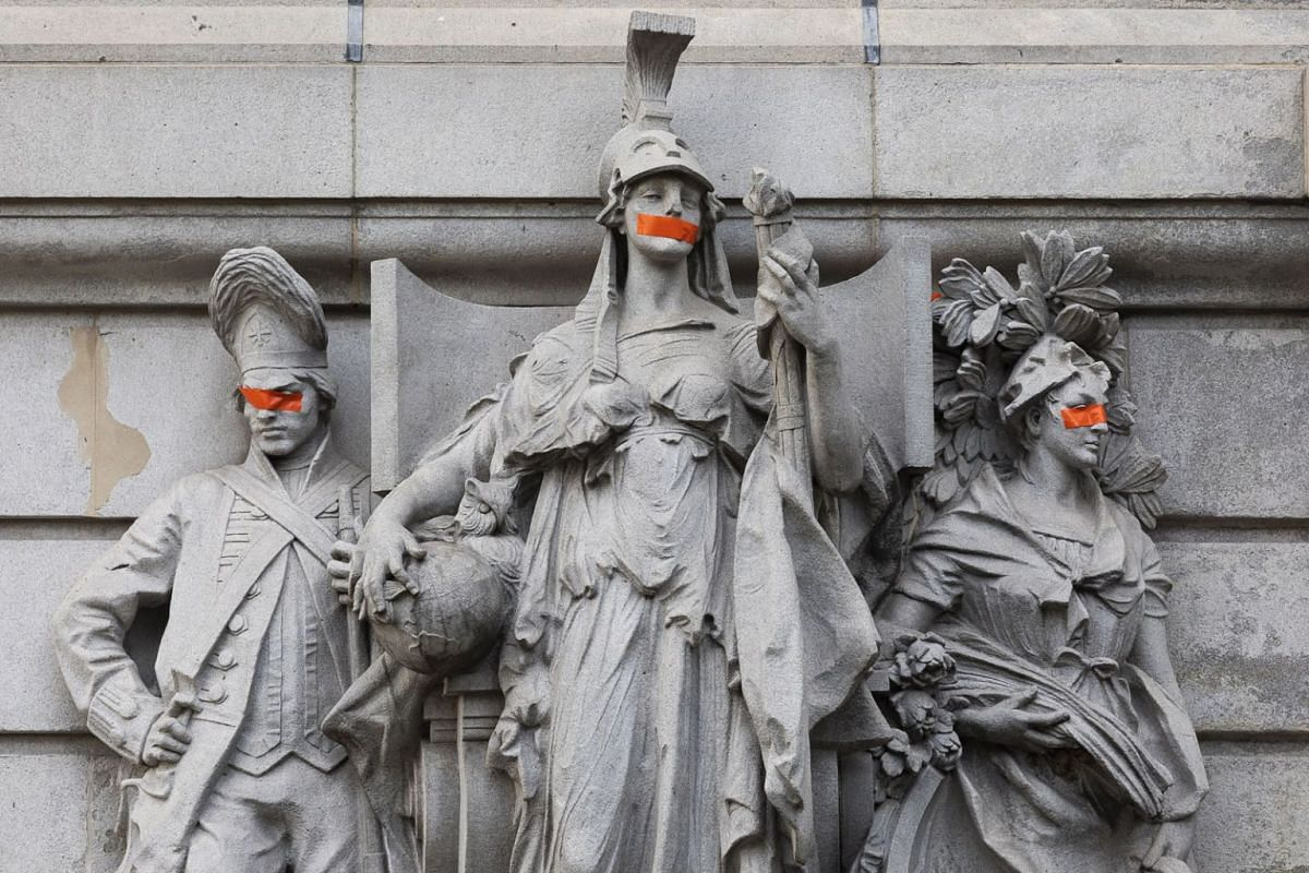 Defaced statues on a municipal building near City Hall where there have been Black Lives Matter protests for weeks in New York city, USA, July 15, 2020. PHOTO: EPA-EFE