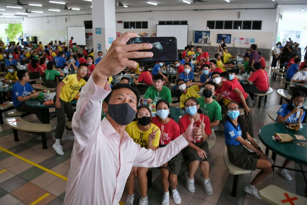 Education Minister Ong Ye Kung taking a wefie with Secondary 4 students at Tampines Secondary on July 16, 2020. Mr Ong was on a visit to the school, where he joined students to commemorate Racial Harmony Day. PHOTO: THE STRAITS TIMES/KUA CHEE SIONG