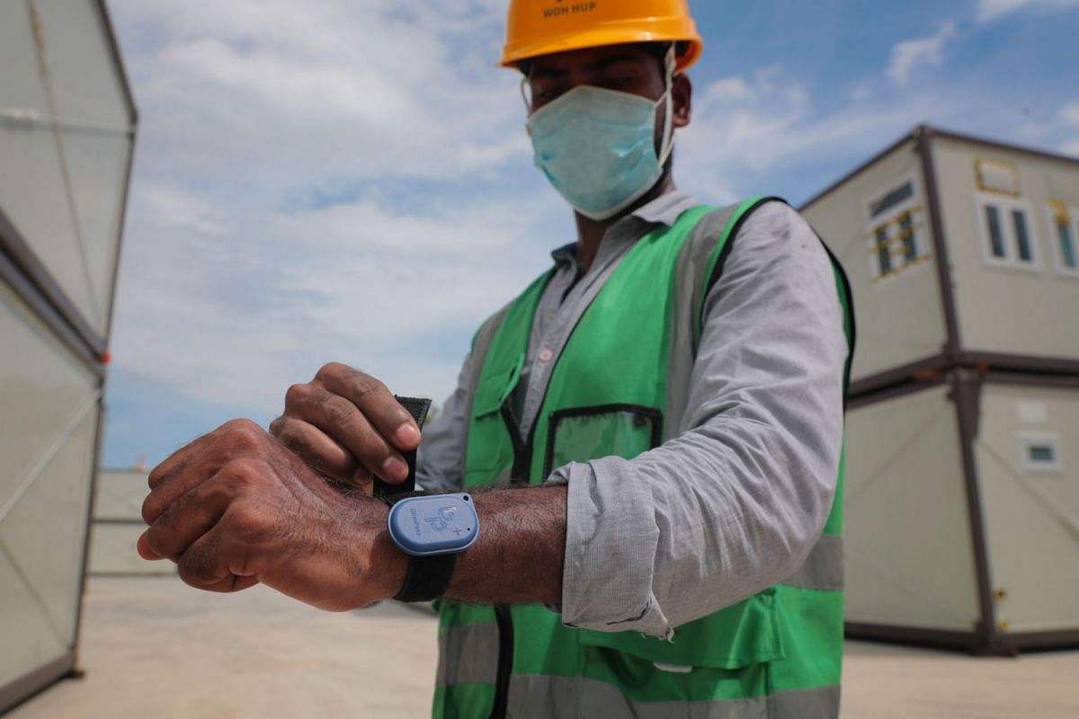 Over 400 workers at a Tampines worksite that Surbana Jurong manages have been issued with a BluePass device as seen in a photo taken on July 15, 2020. The device uses Bluetooth signal exchanges to log nearby users every five to 10 minutes. PHOTO: THE