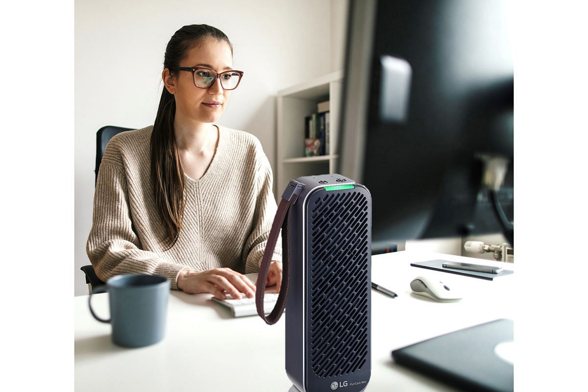 South Korean electronics giant LG's PuriCare portable mini air purifier (above) is about the size of a 500ml bottle of water.