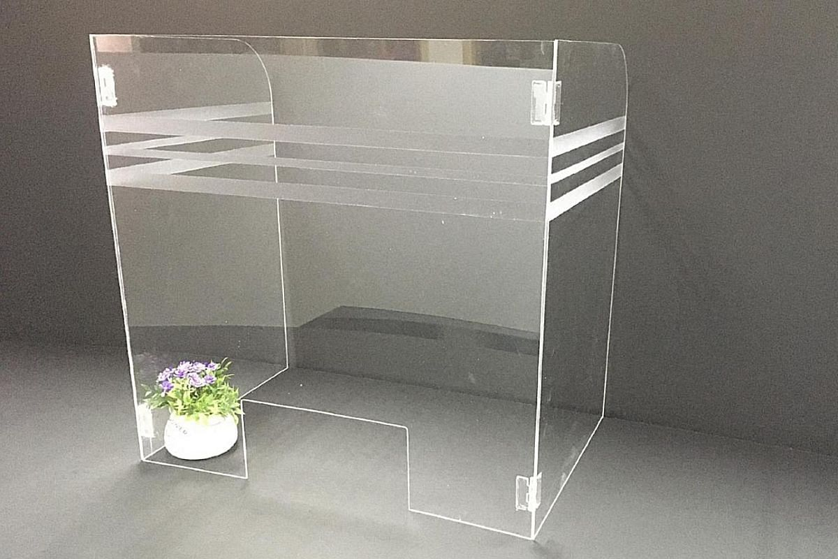 Acrylic desktop dividers by home-grown events-based firm Wah Ye Advertising are available in a variety of sizes.